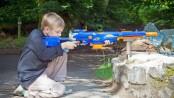 boy using Nerf sniper rifle
