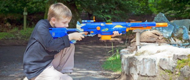 boy using Nerf sniper rifle