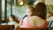 mother with infant on shoulder